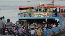 Entering a ferry boat crossing Mekong river,Phnom Penh,Cambodia Footage
