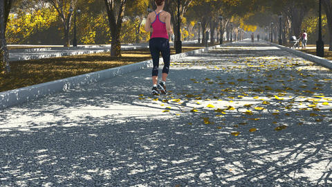 Young woman jogging in the park. Rear view Footage