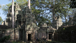 Family with guide enter Ta Prohm temple,Siem Reap,Cambodia Footage