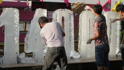 Men making ice sculpture,Bangkok,Loi Krathong,Thailand Footage