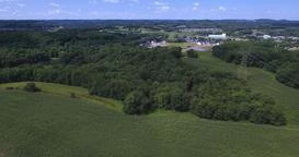 High Angle Aerial over Farmlands and Woods near a Western Pennsylvania Footage