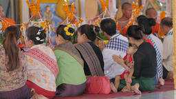 Kid is bored while mother prays in temple,Vientiane,Laos Footage