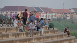 Tourists on riverside stairs at sunset,Vientiane,Laos Footage