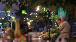 Men selling vegetable food at riverside restaurant,Vientiane,Laos Footage
