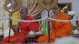 Young and older monk praying in temple,Vientiane,Laos Footage