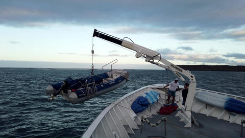 Galapagos, Ecuador - 2019-06-20 - Landing Craft is Winched On Board Tour Boat Live Action