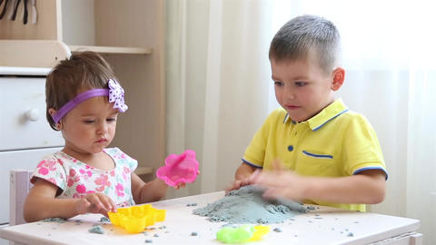 Children in a children's institution play together with kinetic sand Live Action