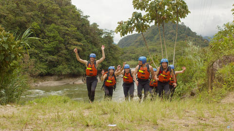 Tourists Celebrating After River Rafting Adventure Footage