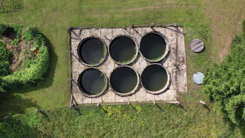 Small primitive sewage treatment plant in province village, aerial view Live Action