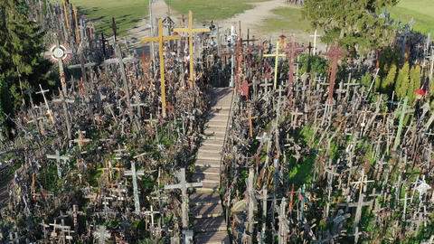 Lithuanian pilgrimage site iconic hill of crosses, aerial view ビデオ