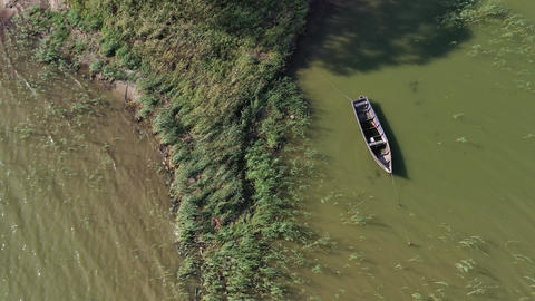 Lonely old wooden fishing boat on sea water, aerial view Live Action