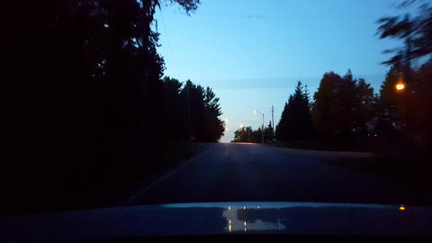Rear View From Back of Car Driving Rural Countryside Road During Night. Car Point of View POV Behind Footage