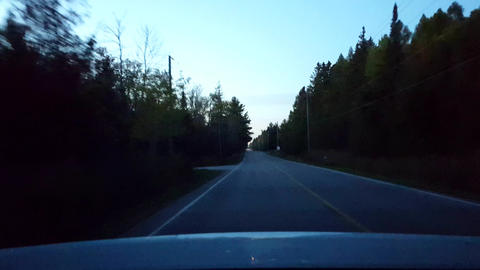 Rear View From Back of Car Driving Rural Countryside Road With Traffic During Night. Car Point of Live Action