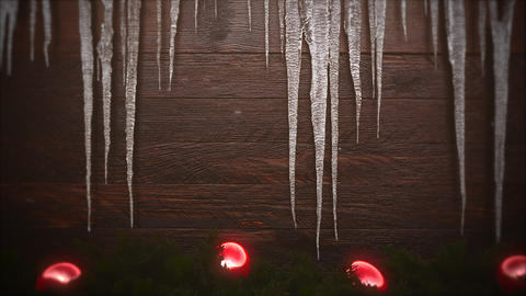 Animated closeup red balls and icicles on wood background Animation