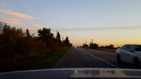 Rear View From Back of Car Stranded on Side of Road Rural Countryside During Day. Car Point of View Footage