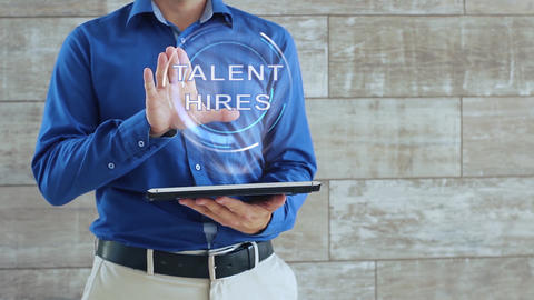 Man uses hologram with text Talent hires Live Action