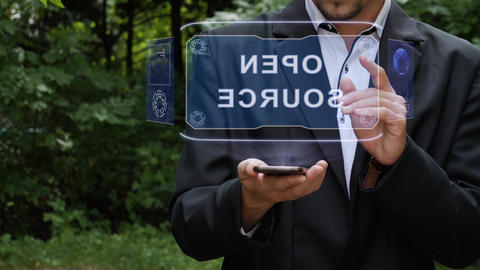 Businessman uses hologram with text Open source Footage