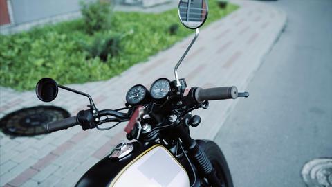 Biker in leather gloves and black hoodie starts motorcycle Footage