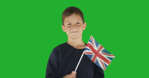 Portrait of boy with flag of great britain. Green screen hromakey background for Live Action