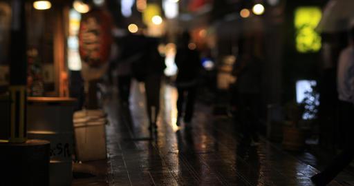 Walking people at the downtown neon street in Nakano Tokyo rainy day ライブ動画