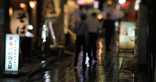 Walking people at the downtown neon street in Nakano Tokyo rainy day ビデオ
