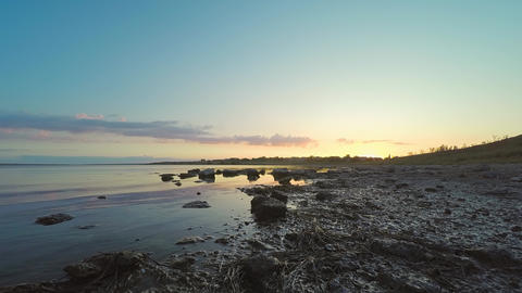 4K timelapse of sunset over the estuary in the Seilian area. Sunset over the Live Action