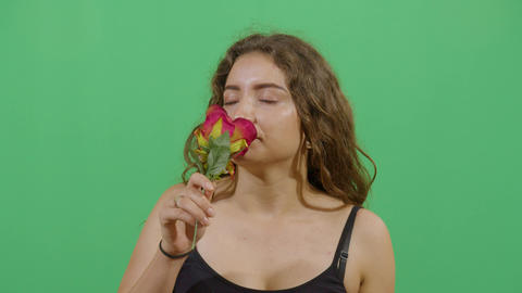 Studio Shot Of A Woman Smelling A Flower Footage