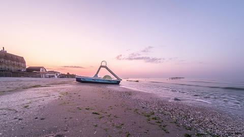 4K timelapse of sunrise over the beach near the sea. Sunrise meadow timelapse Live Action