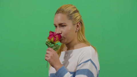 Studio Shot Of A Woman Smelling A Flower Live Action