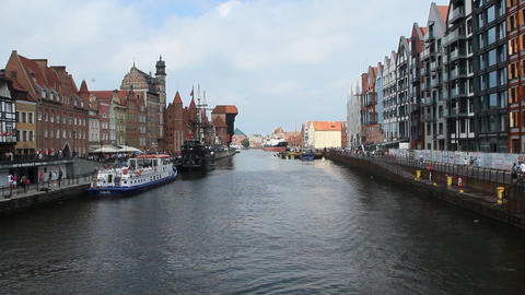 Beautiful views of river and many tourists in Gdansk. Many tourists walk around beautiful tourist Live Action