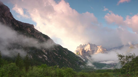 Fog and Clouds over Lake and Mountains. Time Lapse Footage