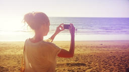 Young Woman Taking Pictures with Smartphone on Beach Footage