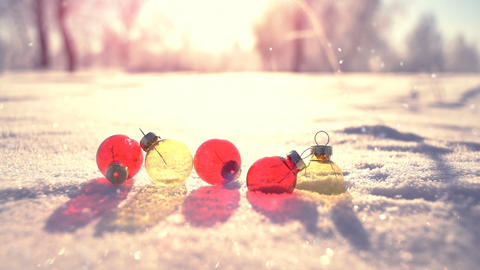 Christmas balls on snow in winter park slowmotion Footage