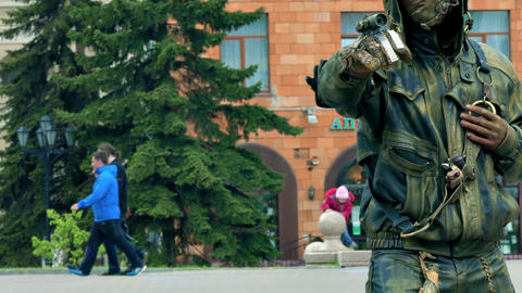Living Statue in Steampunk Style Poses on Street Footage