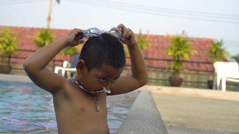 Little boy wearing goggles in swimming pool slowmotion Footage