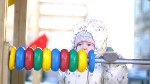 Baby girl playing with colorful abacus Footage