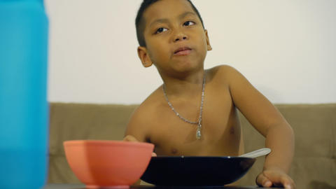 Little Thai boy eating rice Footage