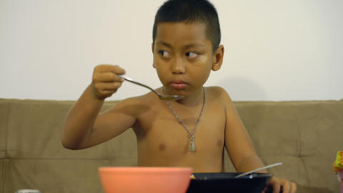 Little Thai boy tasting soup Footage