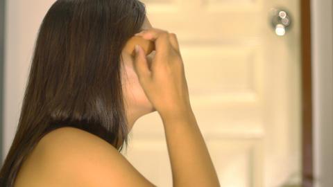 Asian Girl applying tonal foundation on face Footage
