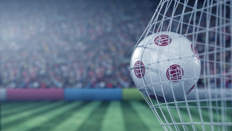 Ball with Club Atletico Lanus football club logo hits football goal net Live Action