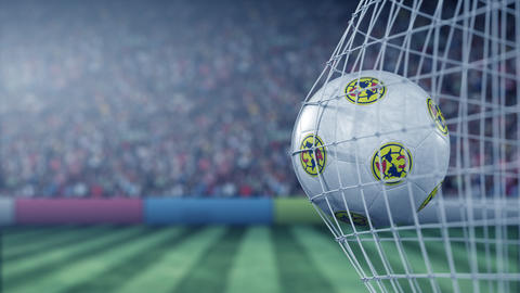 Ball with Club America football club logo hits football goal net. Conceptual Live Action