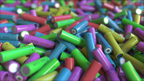 Many multicolor lithium-ion batteries, close-up. 3D animation Footage