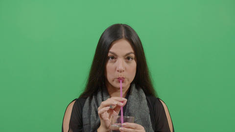 Woman Drinking Water With A Plastic Straw Live Action