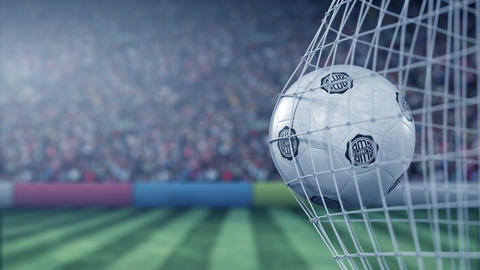 Ball with Club Olimpia football club logo hits football goal net. Conceptual Live Action