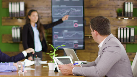 Businessman working in the conference room holding charts Live Action