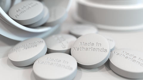 Pills with MADE IN NETHERLANDS text on them. National pharmaceutical industry Live Action