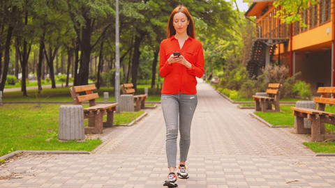 casual girl using smartphone in city Live Action
