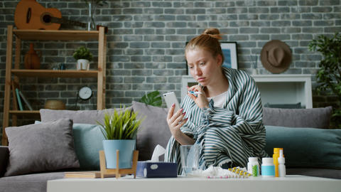 Unhealthy teenager using smartphone for video consultation with doctor talking Live Action