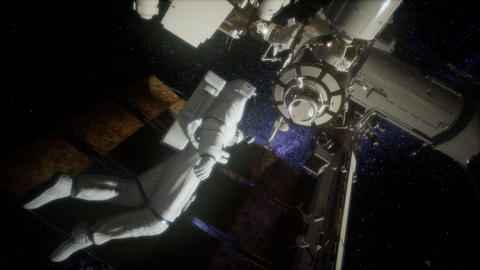 Astronaut outside the International Space Station on a spacewalk Footage