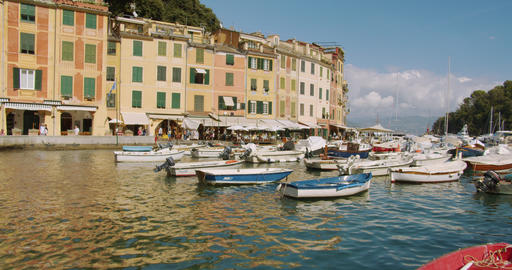 A lot of pleasure and fishing boats in the port of Portofino, Italy. Timelapse Footage